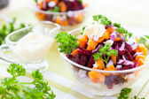 Salad with baked vegetables and herring — Stock Photo