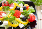 Salad with fresh vegetables and feta cheese — Stock Photo