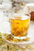 Cup golden linden tea — Stock Photo