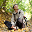 Stock Photo: City dweller in autumn forest