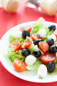 Salad with mozzarella and cherry tomatoes — Stock Photo