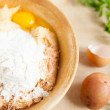 Grated raw potatoes and flour in a bowl — ストック写真