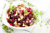 Beetroot salad and nuts, healthy food — Stock Photo