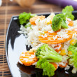 Boiled rice with carrots and broccoli — Stock Photo #18875409