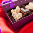 Cookies for Valentine's Day, on red satin — Stockfoto