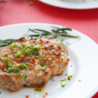 Stock Photo: Grilled pork on a plate and a branch of rosemary