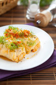 Cabbage rolls with rice and mushrooms on a plate — Stock Photo