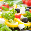 Stock Photo: Delicious fresh vegetable salad with feta