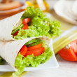 Lettuce and tomatoes wrapped in pita bread — Stock Photo