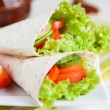 Thin pita bread with lettuce and tomato - Stock Photo