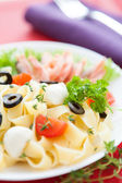 Appetizing pasta with seafood and olives — Stock Photo
