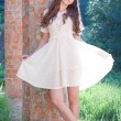 Beautiful girl in a white dress on the nature - Stock Photo