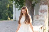 Girl in white dress near the old architecture — Stock Photo