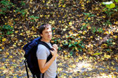 Man tourist in the autumn park — Stock Photo