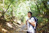 Man tourist on a background autumn nature — Stock Photo