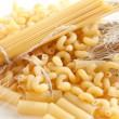 Pasta and wheat spikelets — Stock Photo
