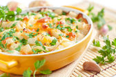 Baked potato with cheese - flavored pudding — Stock Photo