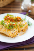 Cabbage roll stuffed with rice on white plate — Stock Photo
