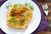 Cabbage roll on white plate, top view — Stock Photo