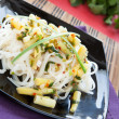 Stock Photo: Rice noodles with vegetables and cilantro