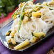 Rice noodles with cilantro and beans — Stock Photo