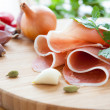 Thin slices of ham on the board - Stock Photo