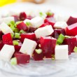 Salad with cubes beets and feta - Stock Photo