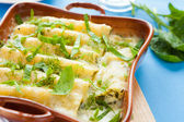 Cannelloni cooked with béchamel sauce — Stock Photo