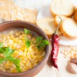 Stock Photo: Fragrant pesoup with croutons