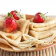 Hot pancakes with strawberries on top — Stock Photo