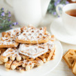 Stock Photo: Ruddy cookies and cup of tea, closeup
