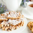 Ruddy cookies and a cup of tea, closeup - Stock Photo