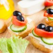 Small canapés with feta and vegetables — Stock Photo