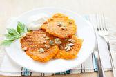Pumpkin pancakes on a white plate — Stock Photo