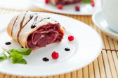 Cherry strudel with chocolate sauce — Stock Photo
