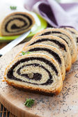 Poppy Roll on a wooden surface — Stock Photo