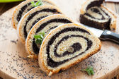 Poppy seed Roll on a wooden surface — Foto de Stock
