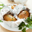 Potatoes cooked in the oven in foil — Stock Photo