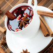 Stock Photo: Glass of mulled wine with almonds
