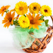 Beautiful bouquet of yellow marigolds in a wicker basket — Stock Photo #20263733