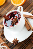 Glass of mulled wine with almonds — Stock Photo