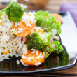 Rice with roasted carrots and broccoli - Stock Photo