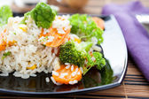 Rice with roasted carrots and broccoli — Stock Photo