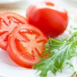 Pieces juicy tomato on a dish — Stock Photo