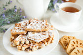 Ruddy cookies and a cup of tea, closeup — Stock Photo