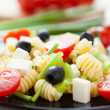 Stock Photo: Cooked macaroni with vegetables and feta