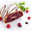 Piece of cherry pie with cranberries on a white plate - 图库照片