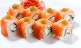 Sushi roll with red fish closeup — Stock Photo