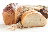 Ready bread and wheat ears — Stock Photo