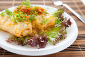 Ukrainian cabbage rolls on a white plate — Stock Photo